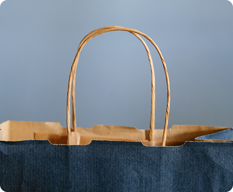 Shopping bag in blue color with grey background
